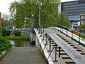 A view over foot and bicycle bridge to the university area Roeterseiland, Amsterdam; high resolution image by FotoDutch in June 2013.jpg