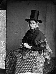 A woman in national dress and knitting (Jones)