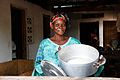 A woman mixing dough to make bread in the town of Masi Manimba, DRC (7610450604).jpg