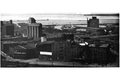 Aerial photograph of two lake freighters, moored in downtown Duluth, from Curwood's 1909 The Great Lakes -ax.png