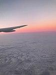 Airplane clouds sky.jpg