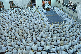 Alavi Bohras - Alavi Bohras in the mosque in front of their da'i listening to the lecture involving the holy Pledge