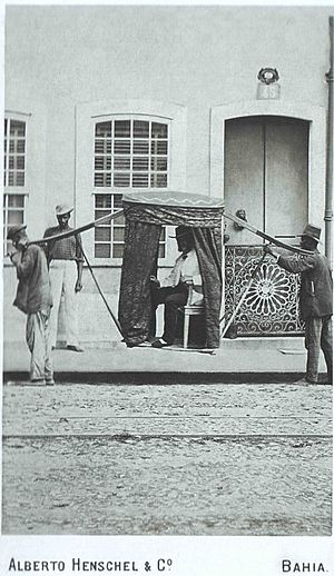 Human rights in Brazil - African slaves carrying a White Brazilian man in Salvador, 1869.