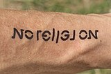 Ambigram tattoo No religion (forearm).jpg