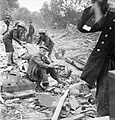An elderly man sits on the pile of rubble which was once his home, following a V1 Flying Bomb strike in the Highland Road and Lunham Road area of Upper Norwood, London, July 1944. D21210.jpg