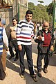 An old man being carried at a polling booth to cast his vote for the Delhi Assembly Election, in New Delhi on February 07, 2015.jpg