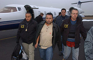 "Norte del Valle Cartel - Arcángel De Jesús Henao Montoya: alias ""El Mocho"" being escorted by ICE agents."