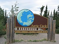 A sign along the Dalton Highway marking the location of the Arctic Circle in Alaska.