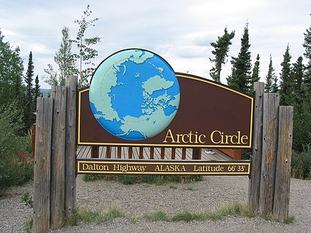 A sign along the Dalton Highway marking the location of the Arctic Circle in Alaska Arctic Circle sign.jpg