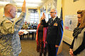 Army Maj. Gen. David Sprynczynatyk, left, the North Dakota adjutant general, administers the oath of office to Air Force Col. John Flowers, the North Dakota National Guard Joint Force Headquarters chaplain 130117-Z-WA217-051.jpg