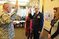 Army Maj. Gen. David Sprynczynatyk, left, the North Dakota adjutant general, administers the oath of office to Air Force Col. John Flowers, the North Dakota National Guard Joint Force Headquarters chaplain 130117-Z-WA217-051.jpg