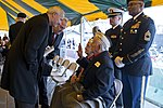 Asa Hutchinson and Joe Smith speak with Pearl Harbor Survivors William M. Chase and Walter Smith.jpg