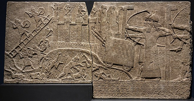 Tiglath-Pileser III besieging a town named U[pa?], possibly in Turkey. Assyrian Relief Attack on Enemy Town from Kalhu (Nimrud) Central Palace reign of Tiglath-pileser III British Museum - 2.jpg