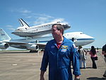Astronaut Mike Foreman In Front Of Space Shuttle Endeavour.JPG
