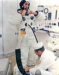 Astronaut Walt Cunningham suiting up.jpg