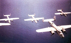 434th Bombardment Squadron - B-25C Mitchells of the 434th Bombardment Squadron flying under the No. 3 Wing, South African Air Force, Ismailia Airfield, Egypt on approach from over the Mediterranean to enemy targets in Libya during late August 1942.