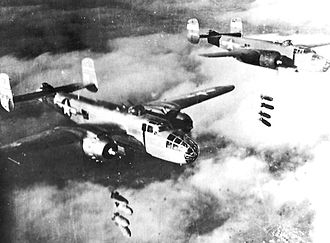 310th Space Wing - B-25Js of the 310th Bombardment Group release 1,000 pound bombs over a cloud-obscured Po Valley in northern Italy, 1944.