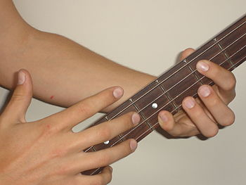 Tapping on a bass guitar