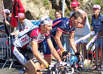 Ivan Basso - Basso (left) alongside Lance Armstrong at the 2004 Tour de France. Basso achieved his first Grand Tour stage victory at the race, on the twelfth stage.