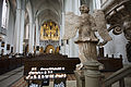 Berlin- A winged marble angel and candles St Marienkirche - 2734.jpg