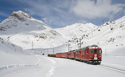 Local train on the Bernina Express line between Lagalb and Ospizio Bernina pulled by two ABe 4/4 multiple units. The two multiple units have excess power with only two passenger cars, so some freight is carried along.