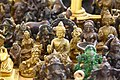 Best view of Small Idols of Buddha and others through camera lens.jpg