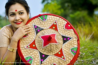 Bohag Bihu - A bihu dancer with Japi (Assamese headgear)