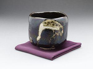 "Raku ware - Black Raku teabowl ""aged pine (shōrei) with crane design by Raku IX (Ryōnyū), Edo period, c. 1810-1838"