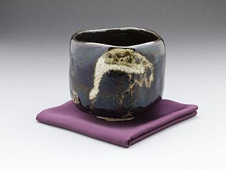 "Raku ware - Black Raku teabowl ""aged pine (shōrei) with crane design by Raku IX (Ryōnyū), Edo period, c. 1810–1838"