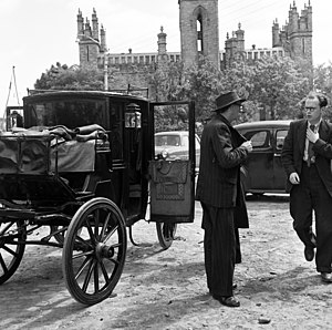 Anthony Cronin - Patrick Kavanagh and Anthony Cronin at the church in Monkstown with the carriage in which they had been proceeding about Dublin in the footsteps of Leopold Bloom, the protagonist in Ulysses, 50 years after Bloom traversed the city in James Joyce's novel.