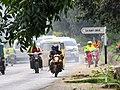 Boda boda with passengers on the move.jpg