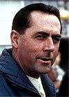 Jack Brabham looking to the left of the camera