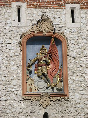 St. Florian's Gate - Bas-relief of St. Florian on the gate tower, facing ulica Floriańska (St. Florian's Street)