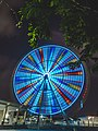 Bright blue illuminated ferris wheel (Unsplash).jpg