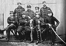 The French military advisers and their Japanese allies in Hokkaido.Back row: Cazeneuve, Marlin, Fukushima Tokinosuke, Fortant.Front row: Hosoya Yasutaro, Jules Brunet, Matsudaira Taro (vice-president of the Ezo Republic), Tajima Kintaro