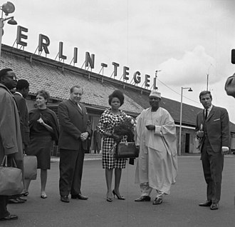 Berlin Tegel Airport - Arrival at Berlin Tegel of a former Nigerian information minister on an official visit to West Berlin on 20 June 1963 (note the original terminal on the airport's north side in the background).
