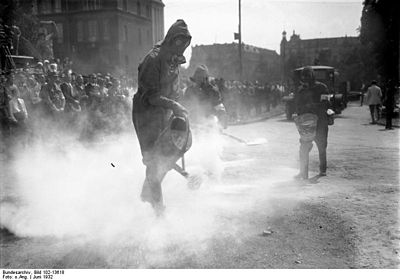 An air defense exercise in Berlin in 1932 that assumed the use of chemical weapons.  He is hardened on a gas mask and sprays antidote.