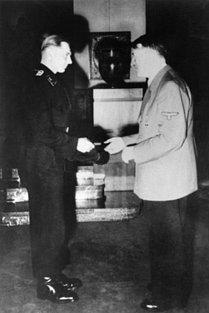Michael Wittmann - Wittmann receiving the Swords to his Knight's Cross of the Iron Cross from Adolf Hitler.
