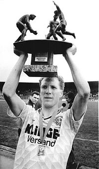 Sammer holds the East German Cup aloft in 1990.