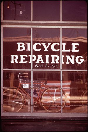 Bicycle mechanic - Repair shop in California, 1972