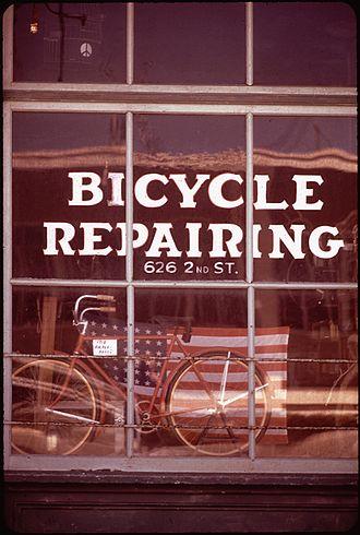 Bicycle mechanic - Repair shop in California, 1972