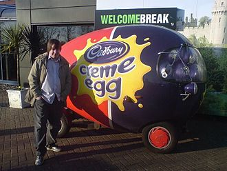 Cadbury Creme Egg - Man standing by Creme Egg Car