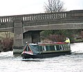 Canal boat passing bridge - geograph.org.uk - 1618574.jpg