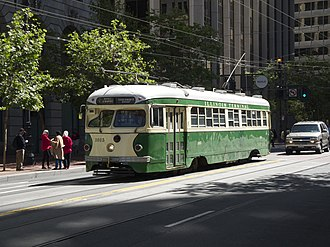 F Market & Wharves - Car 1015, one of San Francisco's original double-ended PCC streetcars, on Market Street near the Ferry Building, painted in the colors of the Illinois Terminal Railroad (St. Louis)