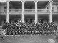 Carlisle Indian School Band Seated on Steps of a School Building, Carlisle, Pennsylvania, 1915 - NARA - 518927.tif