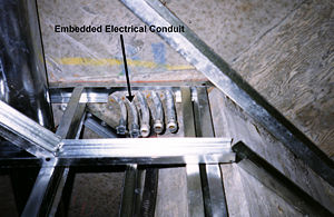 Electrical conduit - Conduit embedded in concrete structure for distribution of electrical cables throughout this highrise apartment building
