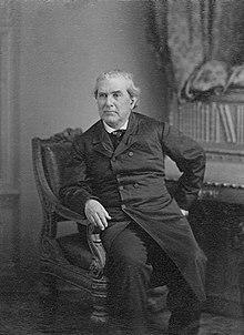 Three-quarter length seated portrait photograph of Charles H. Stonestreet