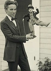 By  Chaplin Was A Global Phenomenon Here He Shows Off Some Of His Merchandise C