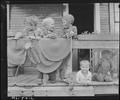 Children of miners on front porch of house in company project. Louise Coal Company, Louise Mine, Osage, Monongalia... - NARA - 540246.tif