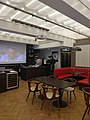 Clareau restaurant interior, projection screen and group tables.jpg